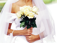 Bride with a white bouquet