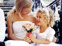 Bride and daughter with flowers